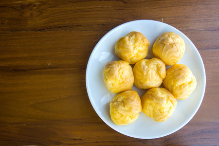 puffs: Cream Puffs on the plate. For Coffee and tea break.