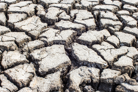 aridness: Dried and Cracked ground soil texture Stock Photo
