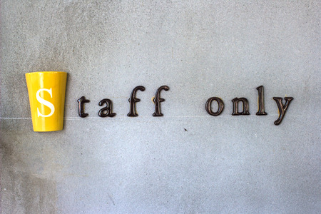 staff only: The word staff only on a cement wall