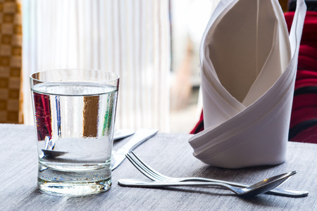 dinning table: Water glass on dinning table
