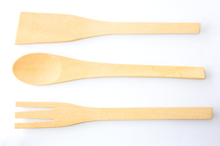 scapula: Authentic kitchen wooden utensil of scapula, spoon and fork isolated over white background