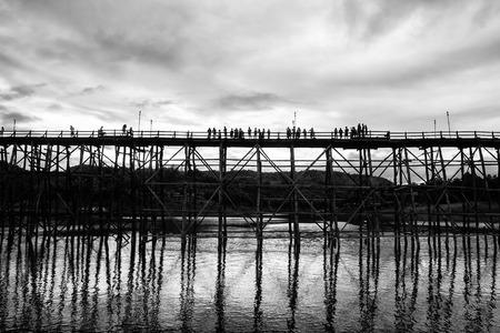 sangkhla buri: Silhouette of wooden Mon Bridge, Sangkhla Buri,Kanchanaburi province, Thailand.Black and white image. Stock Photo