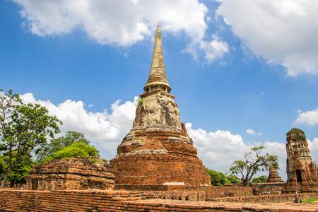 AYUTTHAYA, THAILAND - NOV30, 2015: Tourist travel to visit ancient pagoda at Wat Mahathat temple, Ayutthaya, Thailand