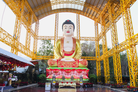 ancient yoga: Chinese Buddha in Nakorn Sawan province, Thailand Editorial