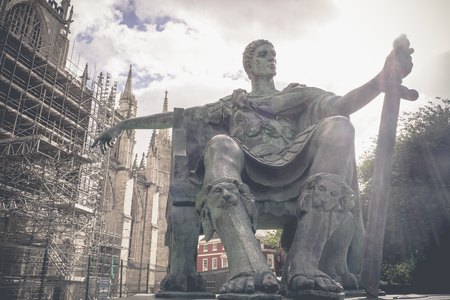 Vintage image, Statue of Roman Emperor Constantine the great with blue sky, York city, UK