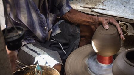 A man mold the pottery with cray at Koh Kred, Nonthaburi, Thailand.