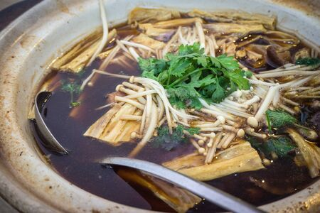 "Asian food named ""Bak kut teh"" is traditional chinese herbal pork ribs soup"