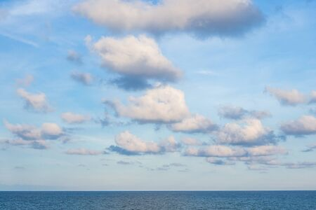 White clouds and blue sky with sea. Stockfoto