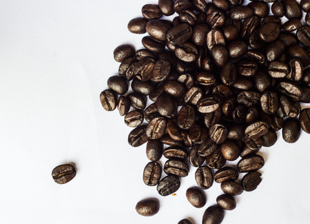 withe: brown coffee beans on the withe ground Stock Photo