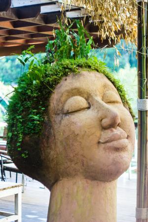 green hair: the statue is green hair in garden