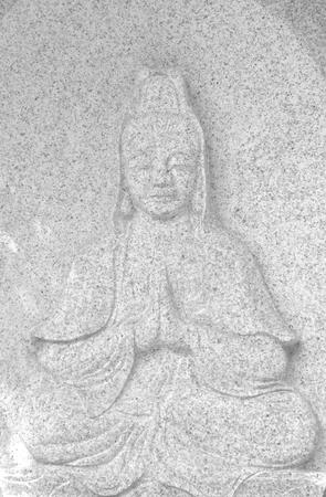 buddha statue on stone.