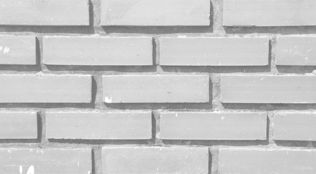 Old white brick wall in a background image.
