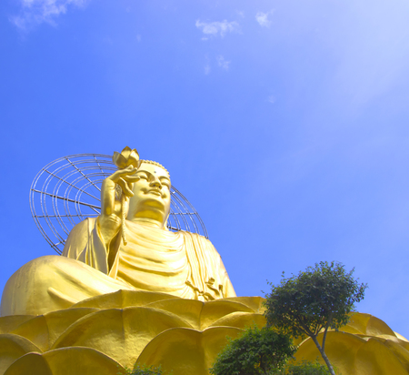 big golden buddha with blue sky and clouds Stock Photo
