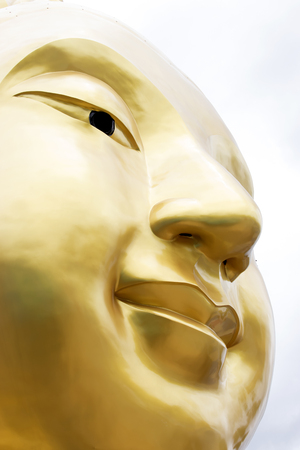 paper textures: face of gold big buddha
