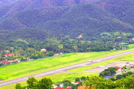 Airport runway with mountain in countryside. Stock Photo