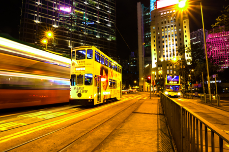 Causeway Bay ,Hong Kong - NOV 23, 2018: Double-decker trams. Trams also a major tourist attraction and one of the most environmentally friendly ways of travelling in Hong Kong. night light