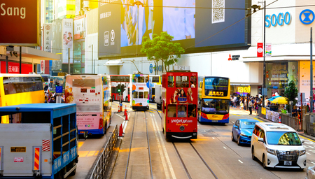 Causeway Bay ,Hong Kong - NOV 23, 2018: Double-decker trams. Trams also a major tourist attraction and one of the most environmentally friendly ways of travelling in Hong Kong.