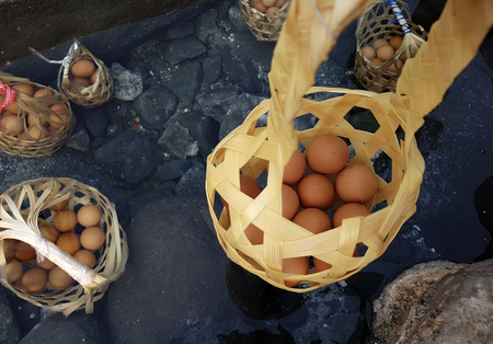 Boiled eggs in natural hot spring, eggs in basket,Soft focus,Select focus. Stock Photo - 122197047