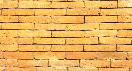 Antique brown brick wall of red color.texture grunge background.may use to interior design