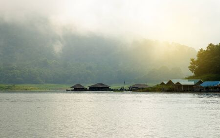 Mountains, hut, lakes and the early morning fog. 版權商用圖片