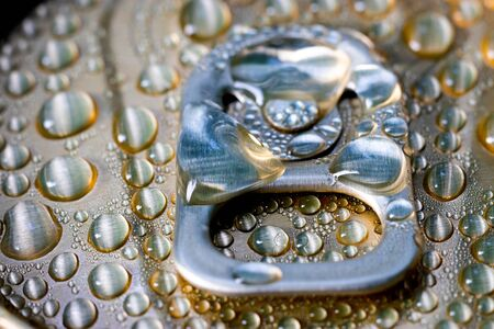 Aluminum can of beverage covered with water drops on background, closeup. Imagens