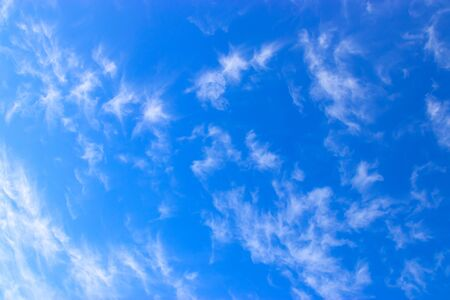 white fluffy clouds in the blue sky. Imagens