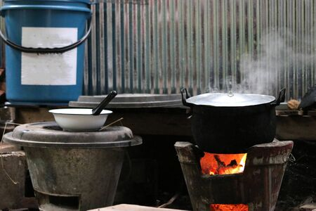 Cooking street food on a hot frying pot.