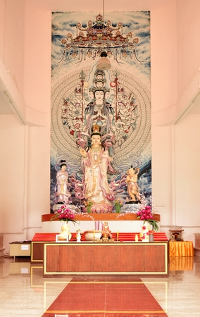 worship god: Red tone of Guanyin statue and her set of alter table in Chinese temple in Hatyai, Thailand (public place)