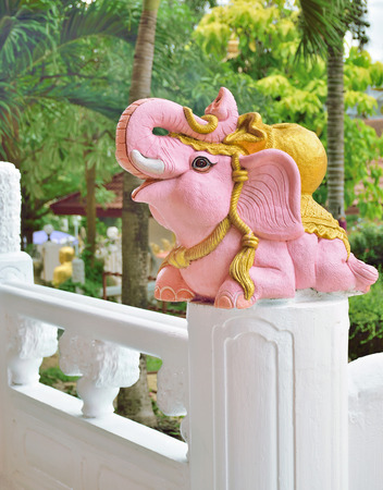 pink elephant: Pink elephant on pillar in Chinese temple, Hatyai, Thailand Editorial
