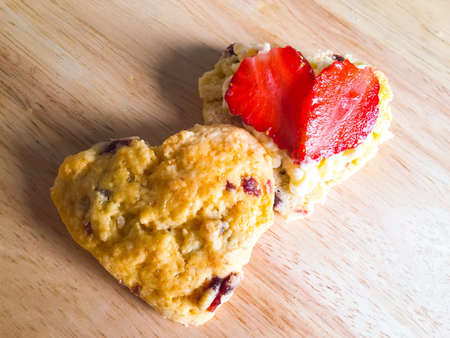 scone: Heart shaped cranberry scone on wooden