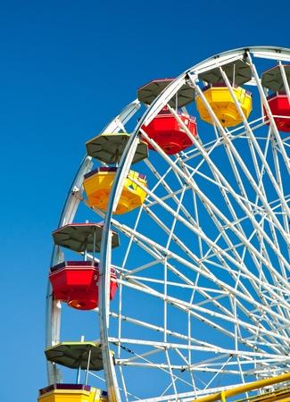 Ferris wheel in blue sky background Stock Photo