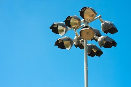 Baseball spotlight pole with clear blue sky background photo