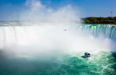 Niagara Falls with tourist boat photo