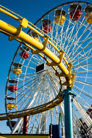 theme park: Close up ferris wheel and roller coaster track