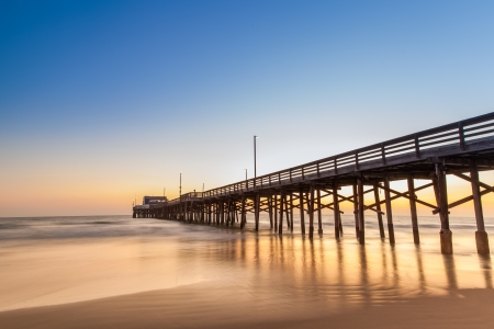 swimming at the beach: Newport Beach pier after sunset