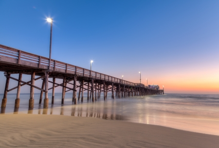 sea dock: Newport Beach pier after sunset