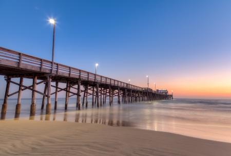 Newport Beach pier na zonsondergang Stockfoto