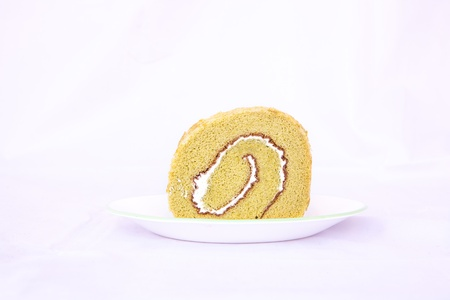 Isolated green tea roll cake in white background