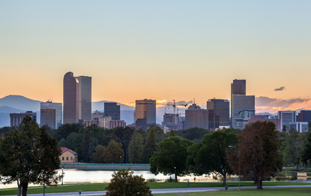 Denver downtown skyline and rocky mountain at sunset photo