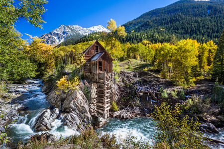 Abandon Crystal Mill in Colorado mountain in falls
