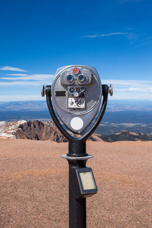 Coin operated telescope on the top of Pike peak summit, Colorado springs  photo
