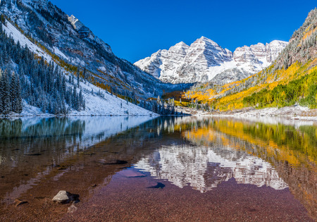 Maroon Bells national park in Falls after early snow storm photo