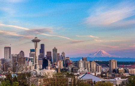 Seattle downtown skyline and Mt Rainier at sunset WA from Kerry park