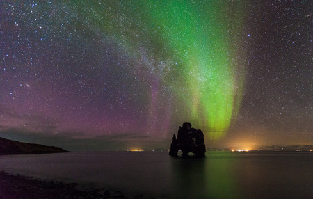 Beautiful Northern light over hvitserkur sea stack, Iceland  photo