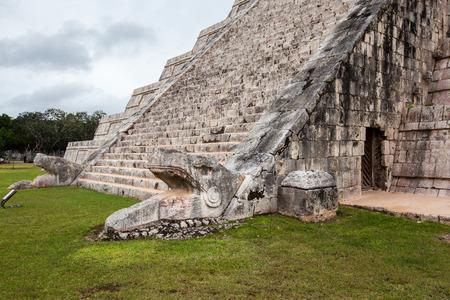 Serpent head stairway in El Castillo Pyramid, Chichen Itza, Mexico. photo