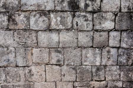 Ancient stone wall in Chichen Itza, Mexico photo