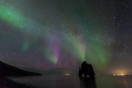 Northern light at hvitserkur, Iceland photo