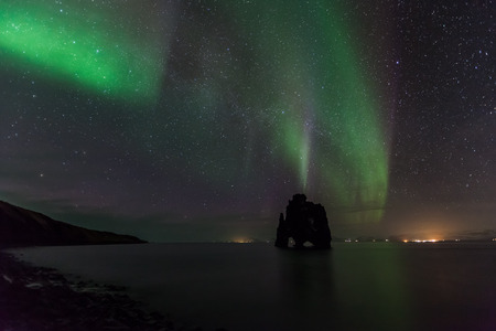 Beautiful Northern light at hvitserkur, Iceland. photo