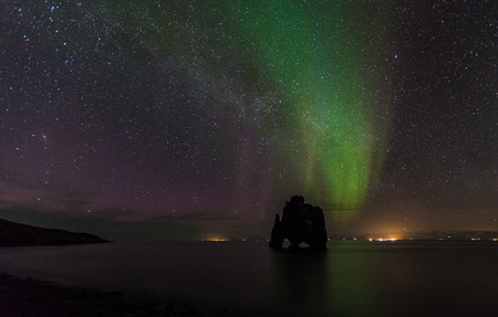 Beautiful aurora borealis at hvitserkur, Iceland. photo