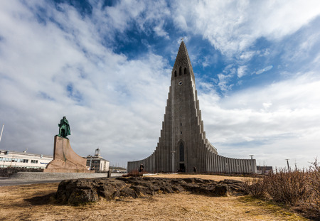 leif: REYKJAVIK, ICELAND - April 03: Hallgrimskirkja Church is a famous and largest church in Reykjavik, Iceland, with statue of Leif Erikson,on April 03, 2014 Editorial